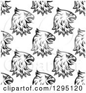Clipart Of A Seamless Background Pattern Of Black And White Eagle Or Griffin Heads Royalty Free Vector Illustration by Vector Tradition SM