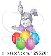 Clipart Of A Happy Gray Easter Bunny Rabbit Waving Behind Colorful Easter Eggs Royalty Free Vector Illustration