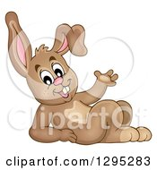 Clipart Of A Happy Brown Bunny Rabbit Leaning Back And Waving Royalty Free Vector Illustration by visekart