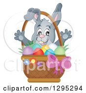 Clipart Of A Happy Gray Easter Bunny Popping Out From Behind A Basket Of Eggs Royalty Free Vector Illustration