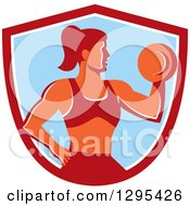 Clipart Of A Retro Muscular Fit Woman Working Out With A Dumbbell And Doing Bicep Curls In A Red White And Blue Shield Royalty Free Vector Illustration by patrimonio