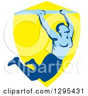 Clipart Of A Retro Strong Male Bodybuilder Doing Pull Ups On A Bar Over A Yellow Shield Royalty Free Vector Illustration by patrimonio