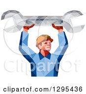 Clipart Of A Retro Low Poly Male Mechanic Holding Up A Spanner Wrench Royalty Free Vector Illustration