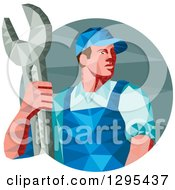 Clipart Of A Retro Low Poly Male Mechanic Holding A Spanner Wrench In A Circle Royalty Free Vector Illustration