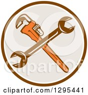 Clipart Of A Crossed Plumber Monkey Wrench And Spanner Wrench In A Brown White And Taupe Circle Royalty Free Vector Illustration