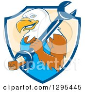 Clipart Of A Cartoon Bald Eagle Mechanic With A Wrench In A Blue White And Pastel Orange Shield Royalty Free Vector Illustration