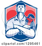 Retro Male Plumber With Folded Arms Holding A Monkey Wrench In A Blue White And Red Shield