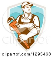Clipart Of A Retro Male Plumber Holding A Monkey Wrench And Rolling Up His Sleeves In A Taupe White And Turquoise Shield Royalty Free Vector Illustration