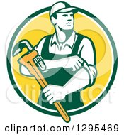 Clipart Of A Retro Male Plumber Holding A Monkey Wrench And Rolling Up His Sleeves In A Green White And Yellow Circle Royalty Free Vector Illustration