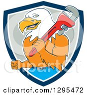 Clipart Of A Cartoon Bald Eagle Plumber With A Monkey Wrench In A Blue White And Gray Shield Royalty Free Vector Illustration