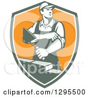 Clipart Of A Retro Male Mason Worker Rolling Up His Sleeves And Laying A Brick Wall In A Shield Royalty Free Vector Illustration by patrimonio