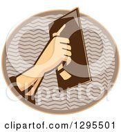 Clipart Of A Retro Male Plasterer Hand Working In A Brown And Orange Oval Royalty Free Vector Illustration