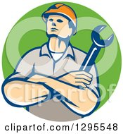 Retro Caucasian Male Construction Or Builder Worker With Folded Arms And A Wrench In A Green Circle
