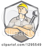 Clipart Of A Retro Caucasian Male Construction Or Builder Worker With Folded Arms And A Wrench In A Gray Shield Royalty Free Vector Illustration