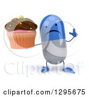 Clipart Of A 3d Unhappy Blue And White Pill Character Holding Up A Finger And A Chocolate Frosted Cupcake Royalty Free Illustration