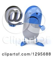 3d Unhappy Blue And White Pill Character Holding And Pointing To An Email Arobase At Symbol