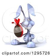 Clipart Of A 3d Blue Bunny Rabbit Facing Slightly Left And Holding A Chocolate Easter Egg 2 Royalty Free Illustration