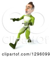 Clipart Of A 3d Young Brunette White Male Super Hero In A Green Suit Walking To The Left And Pointing Royalty Free Illustration