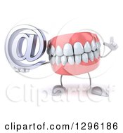 3d Mouth Teeth Mascot Holding Up A Finger And An Email Arobase At Symbol