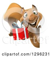 Clipart Of A 3d Squirrel Holding A Gift Around A Sign Royalty Free Illustration