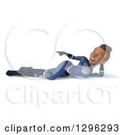 Clipart Of A 3d Young Black Female Super Hero In A Dark Blue Suit Resting And Pointing To The Left Royalty Free Illustration by Julos