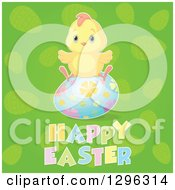 Clipart Of A Cute Yellow Chick Sitting On A Floral Egg Over Happy Easter Text On Green Royalty Free Vector Illustration