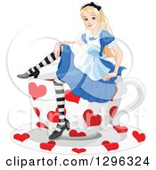 Relaxed Alice In Wonderland Sitting On A Giant Heart Patterned Tea Cup