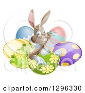 Clipart Of A Happy Brown Easter Bunny Sitting And Pointing From An Egg Shell Royalty Free Vector Illustration