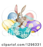 Clipart Of A Happy Brown Easter Bunny Sitting In An Egg Shell Royalty Free Vector Illustration by AtStockIllustration