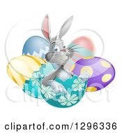 Clipart Of A Happy Gray Easter Bunny Sitting And Pointing From An Egg Shell Royalty Free Vector Illustration by AtStockIllustration