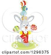 Clipart Of A Gray Bunny Rabbit Balancing Easter Eggs Royalty Free Vector Illustration
