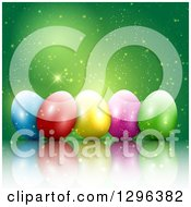 Clipart Of A 3d Colorful Easter Eggs With Magic Sparkles On Green Royalty Free Vector Illustration
