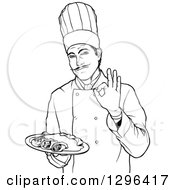 Black And White Male Chef Holding A Plate Of Enchiladas And Gesturing Ok