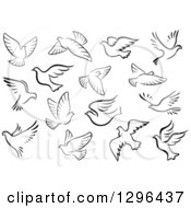 Clipart Of Black And White Flying Dove Birds Royalty Free Vector Illustration