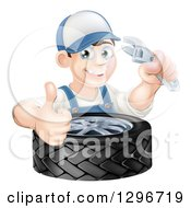 Poster, Art Print Of Happy Young Brunette White Mechanic Man Wearing A Baseball Cap Holding A Wrench And Thumb Up Over A Tire