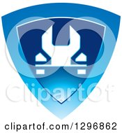 Clipart Of A White Wrench In A Shiny Blue Shield Royalty Free Vector Illustration by Lal Perera