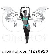 Clipart Of A Silhouetted Stretching Female Bodybuilder With Silver Butterfly Wings In A Gradient Suit Royalty Free Vector Illustration