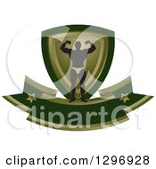 Clipart Of A Silhouetted Flexing Male Bodybuilder With A Green And Gold Shield And Blank Banner Royalty Free Vector Illustration