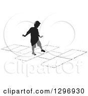 Clipart Of A Black Silhouetted Boy Playing Hopscotch Royalty Free Vector Illustration by Lal Perera