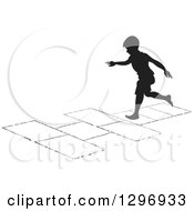 Clipart Of A Black Silhouetted Boy Playing Hopscotch 4 Royalty Free Vector Illustration