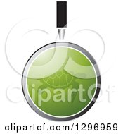 Clipart Of A Magnifying Glass Over A Green Sea Turtle Royalty Free Vector Illustration by Lal Perera