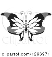 Clipart Of A Black And White Butterfly With Petal Patterned And Face Tipped Wings Royalty Free Vector Illustration