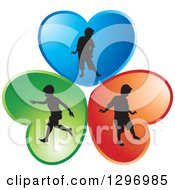 Clipart Of Black Silhouetted Boys Playing In Blue Red And Green Hearts Royalty Free Vector Illustration