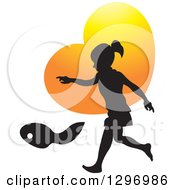 Black Silhouetted Girl Playing Over An Orange Heart
