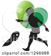 Clipart Of A Black Silhouetted Boy Playing Over A Green Heart Royalty Free Vector Illustration