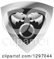 Clipart Of Roaring Tiger Heads Over A Circle In A Silver And Black Shield Royalty Free Vector Illustration by Lal Perera