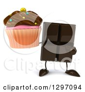 Clipart Of A 3d Chocolate Candy Bar Character Holding And Pointing To A Cupcake Royalty Free Illustration