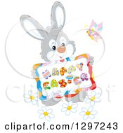 Clipart Of A Cartoon Happy Gray Bunny Rabbit Holding A Happy Easter Sign With A Butterfly And Flowers Royalty Free Vector Illustration