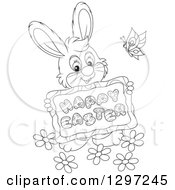 Clipart Of A Cartoon Happy Black And White Bunny Holding A Happy Easter Sign With A Butterfly And Flowers Royalty Free Vector Illustration