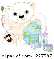 Cute Polar Bear Cub Painting An Easter Egg With Vines
